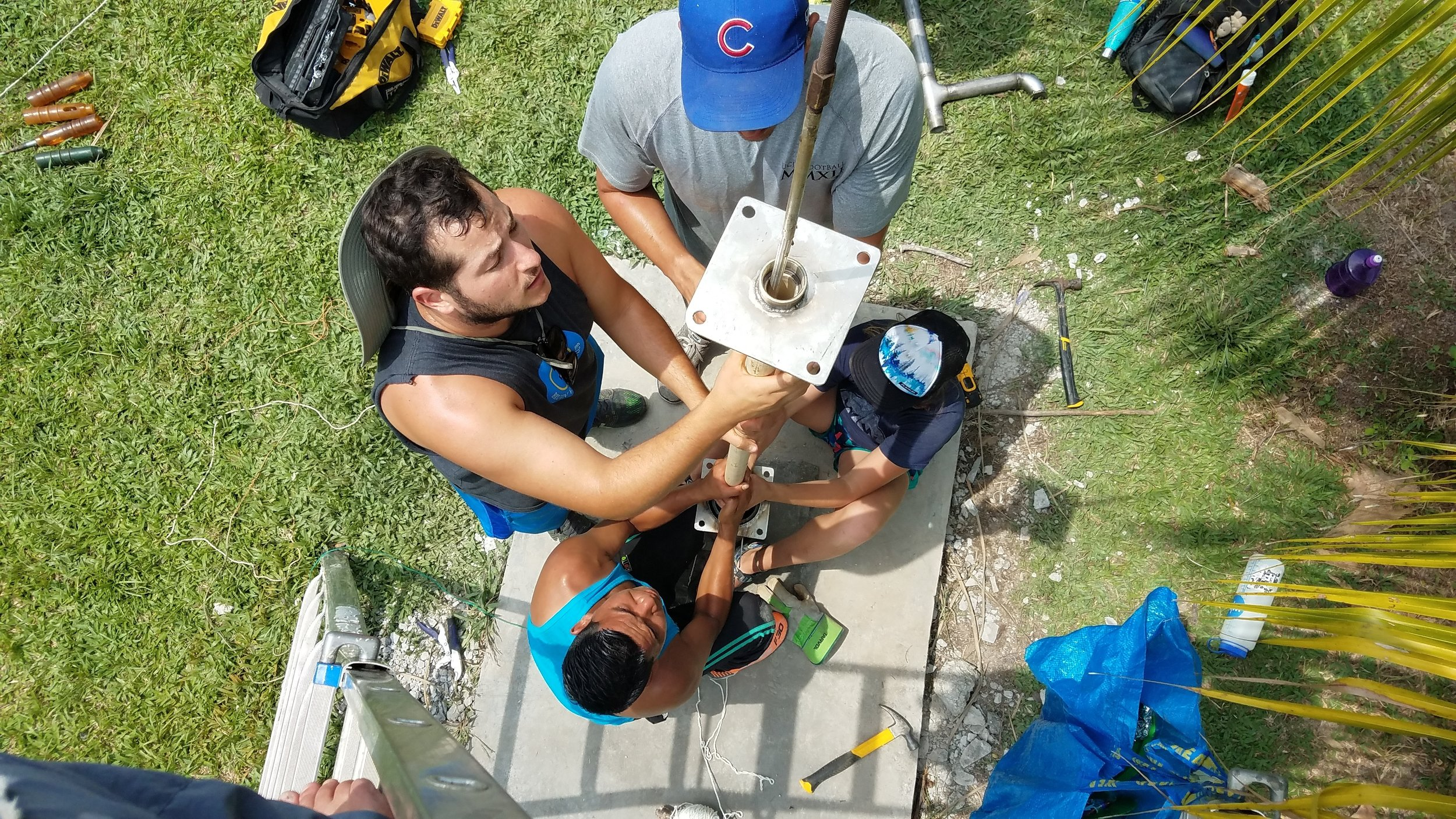 Community members work constructing a well in the Amazon