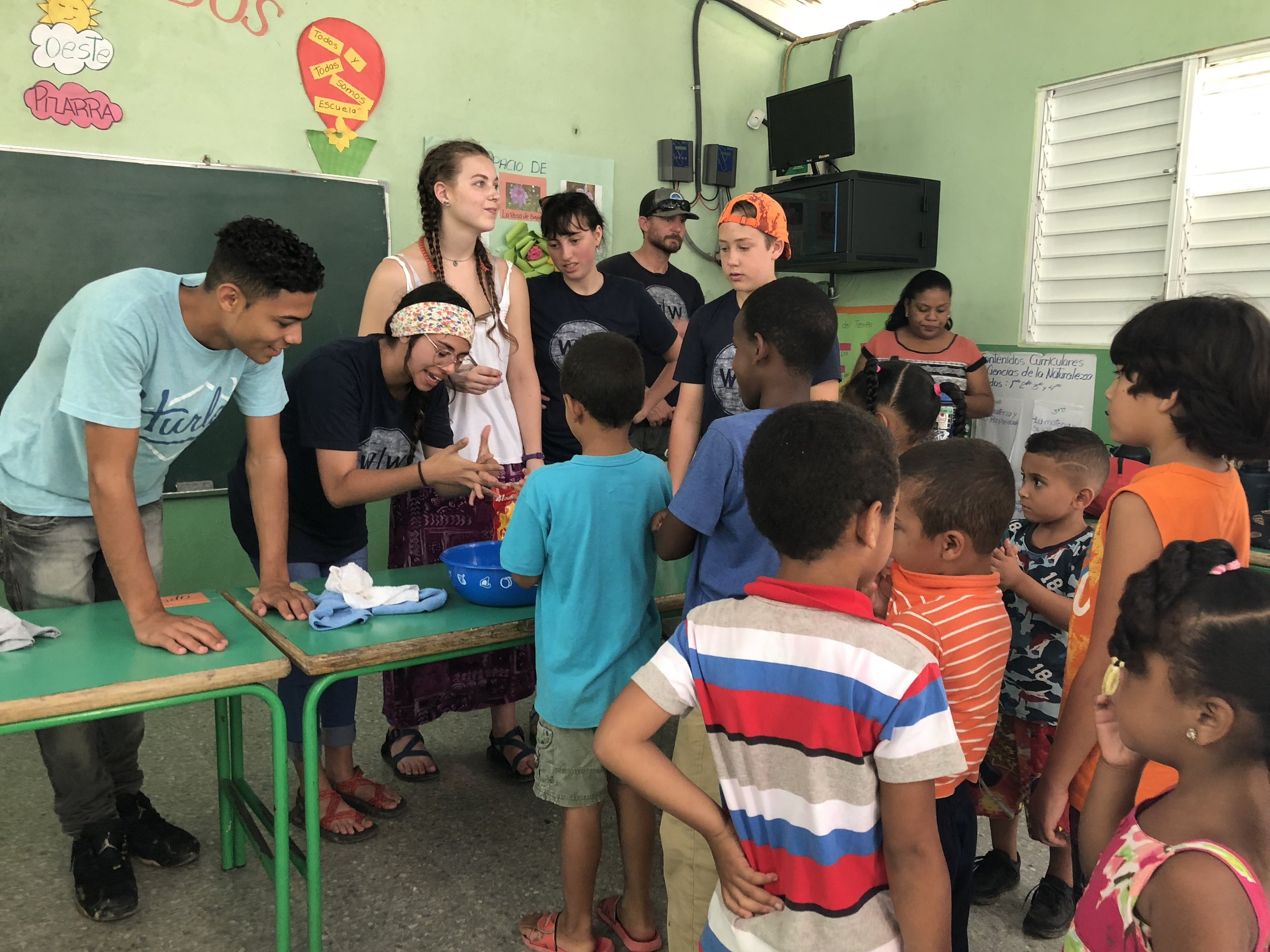Volunteers teaching proper hand washing techniques in the Dominican Republic.