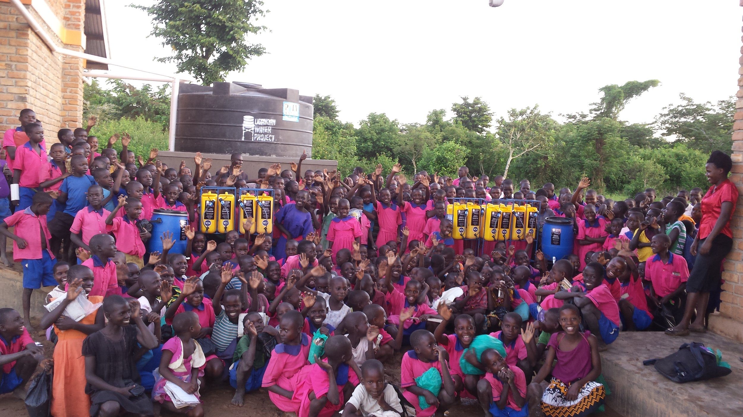 Students and Staff at Bulemezi Primary School receive new water filters. Image courtesy of Ugandan Water Project.