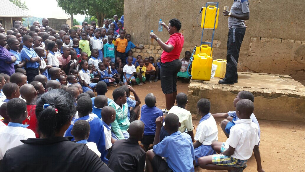 St. Balikudembe students learn how to use their new Sawyer filters. Image courtesy of Ugandan Water Project