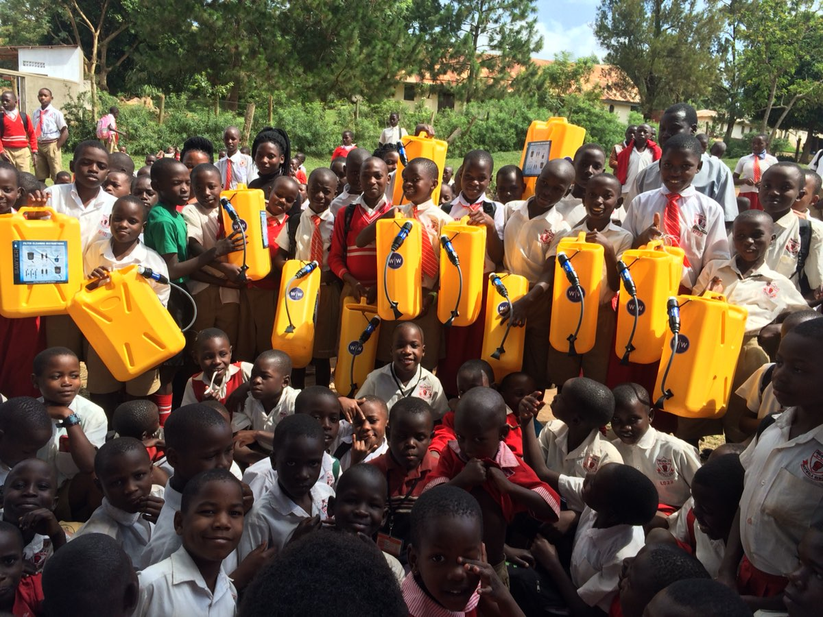 Nsangi Primary School students with their new water filters. Image courtesy of Ugandan Water Project.