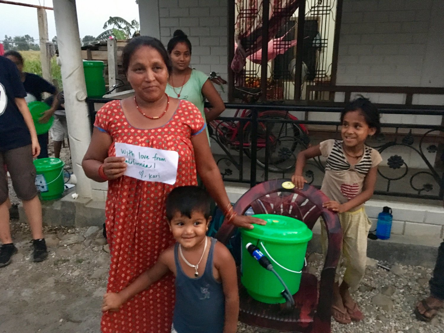 Fig. 9 This family in Riatole, Nepal, proud recipients of a Sawyer Filter.