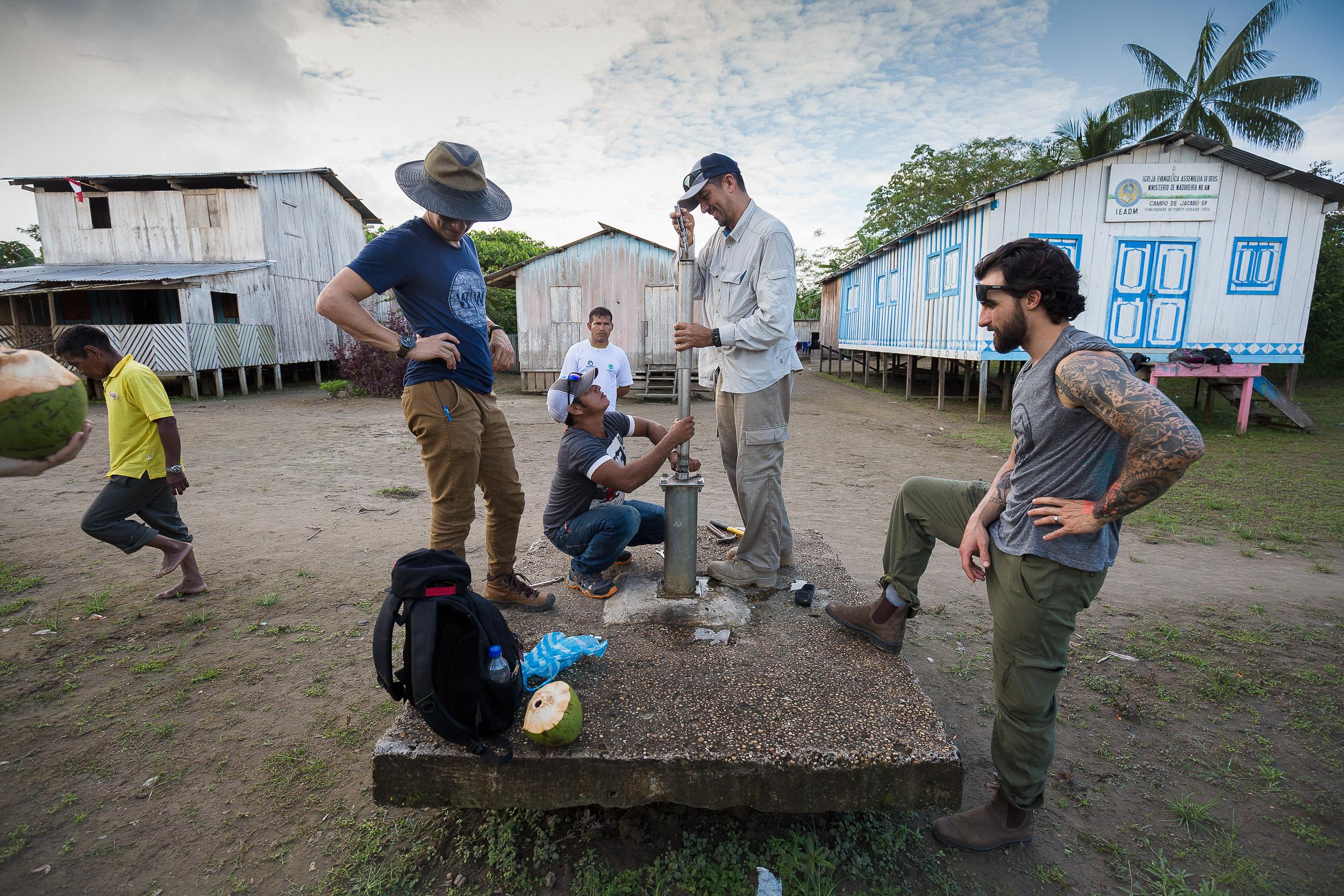 Field Technicians Gustavo (center left) and Gonzalo Jimenez (center right) repair a broken well.