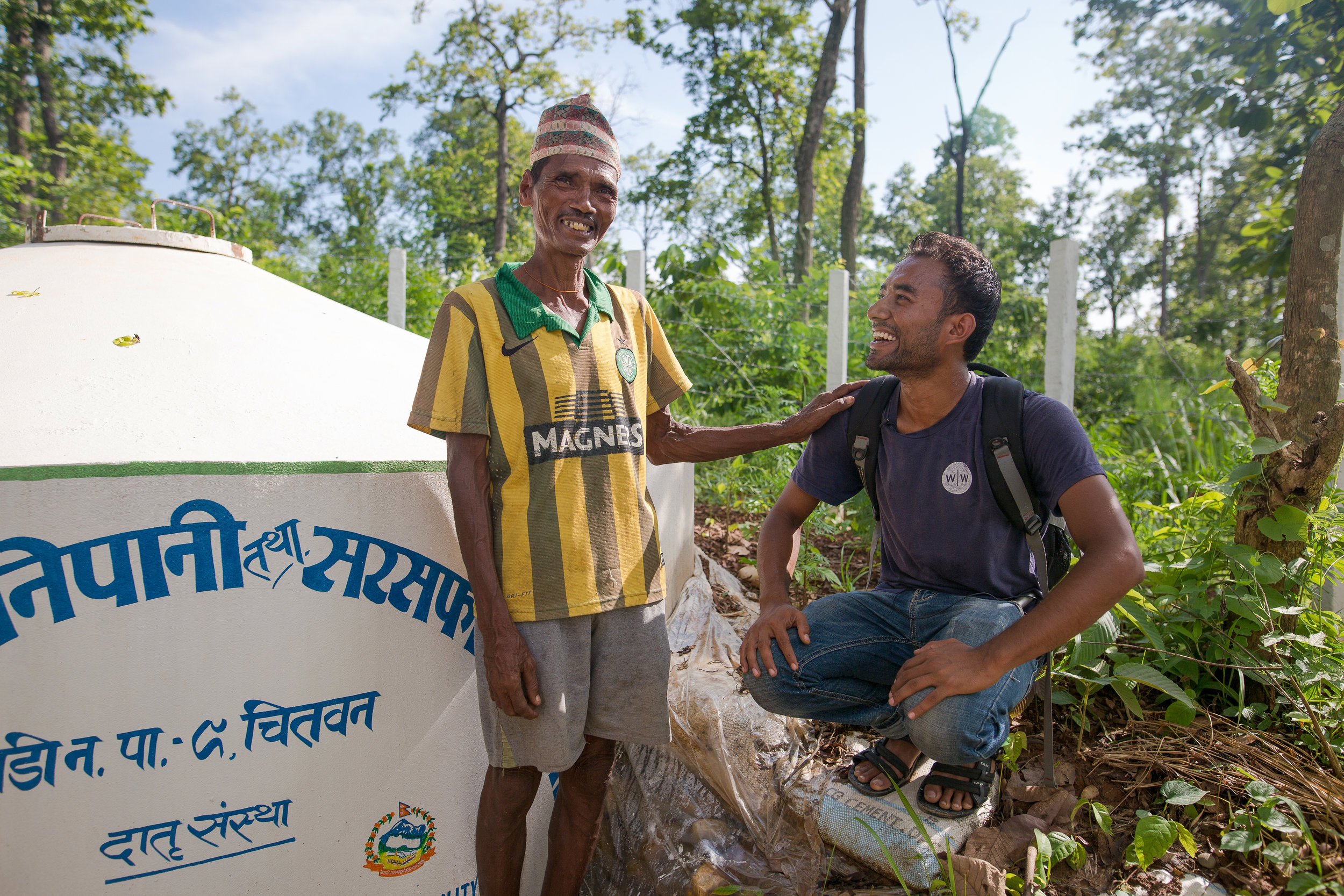 Abhishek talks with Sankur about the reservoir tank that stores water for the whole community.
