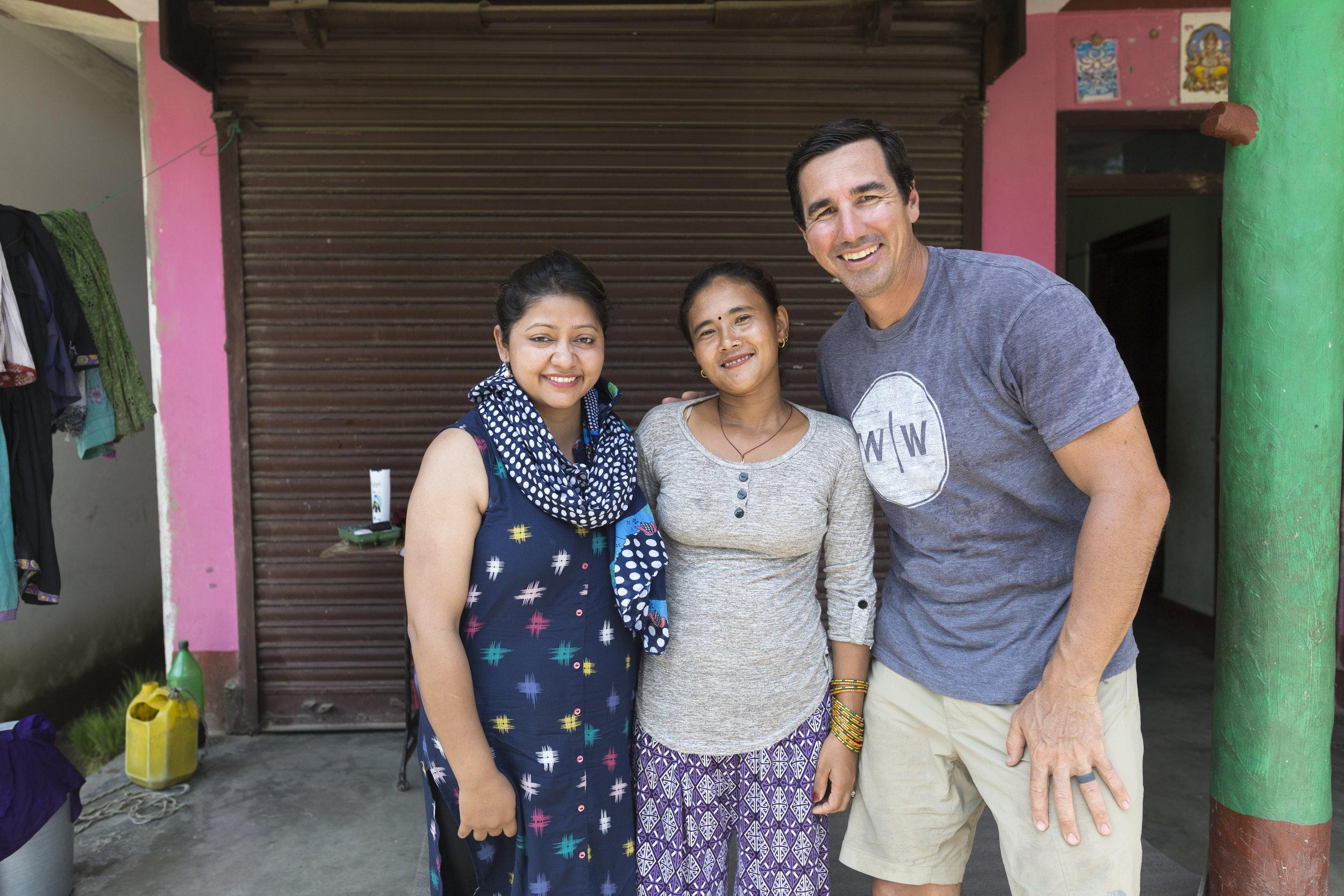 Roshani and David talk with the Raitole president of the water user group committee, Naramaya Rai (center).