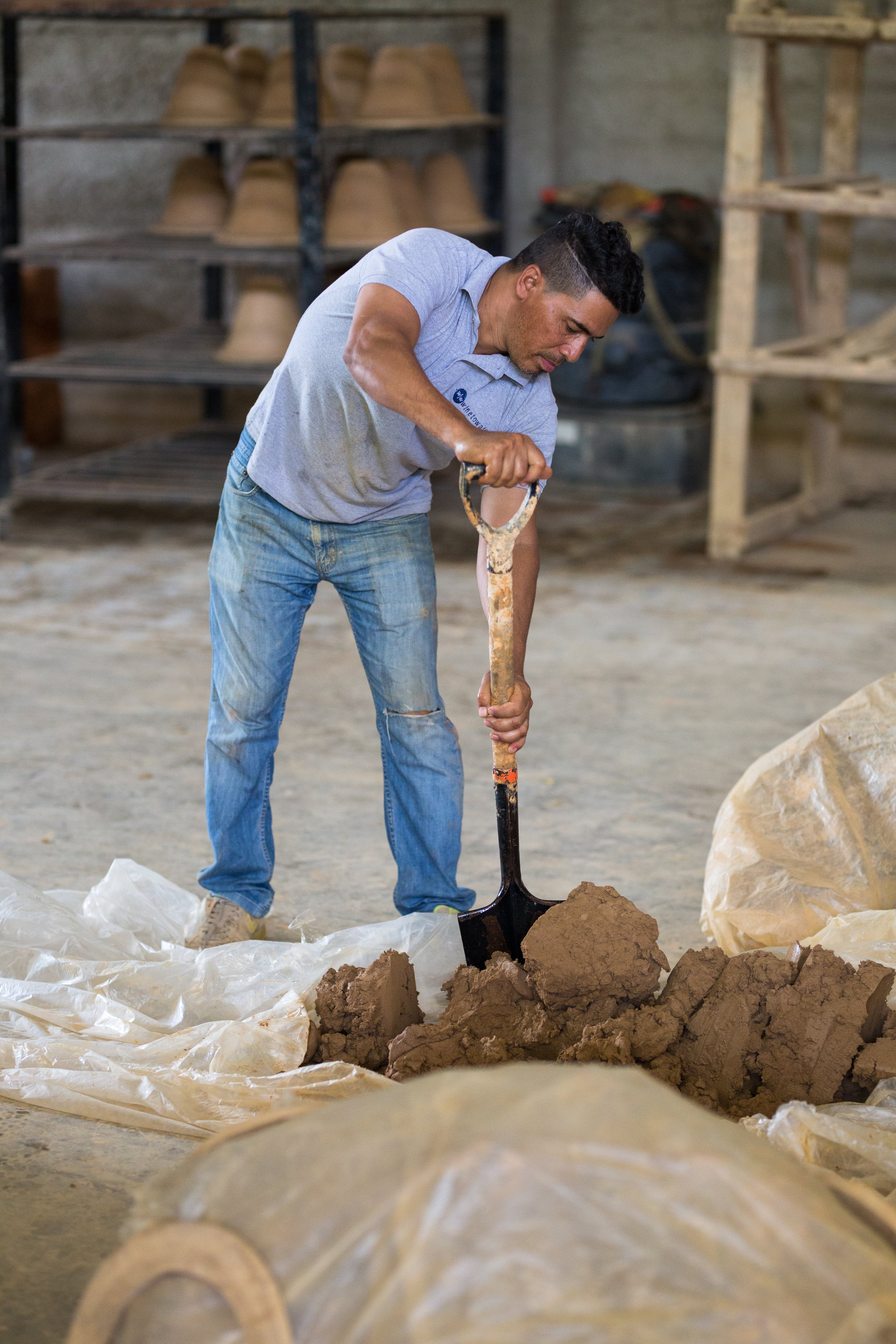 Domingo Guzman, DR Factory Manager, prepares the clay that will be used to make the ceramic filters.