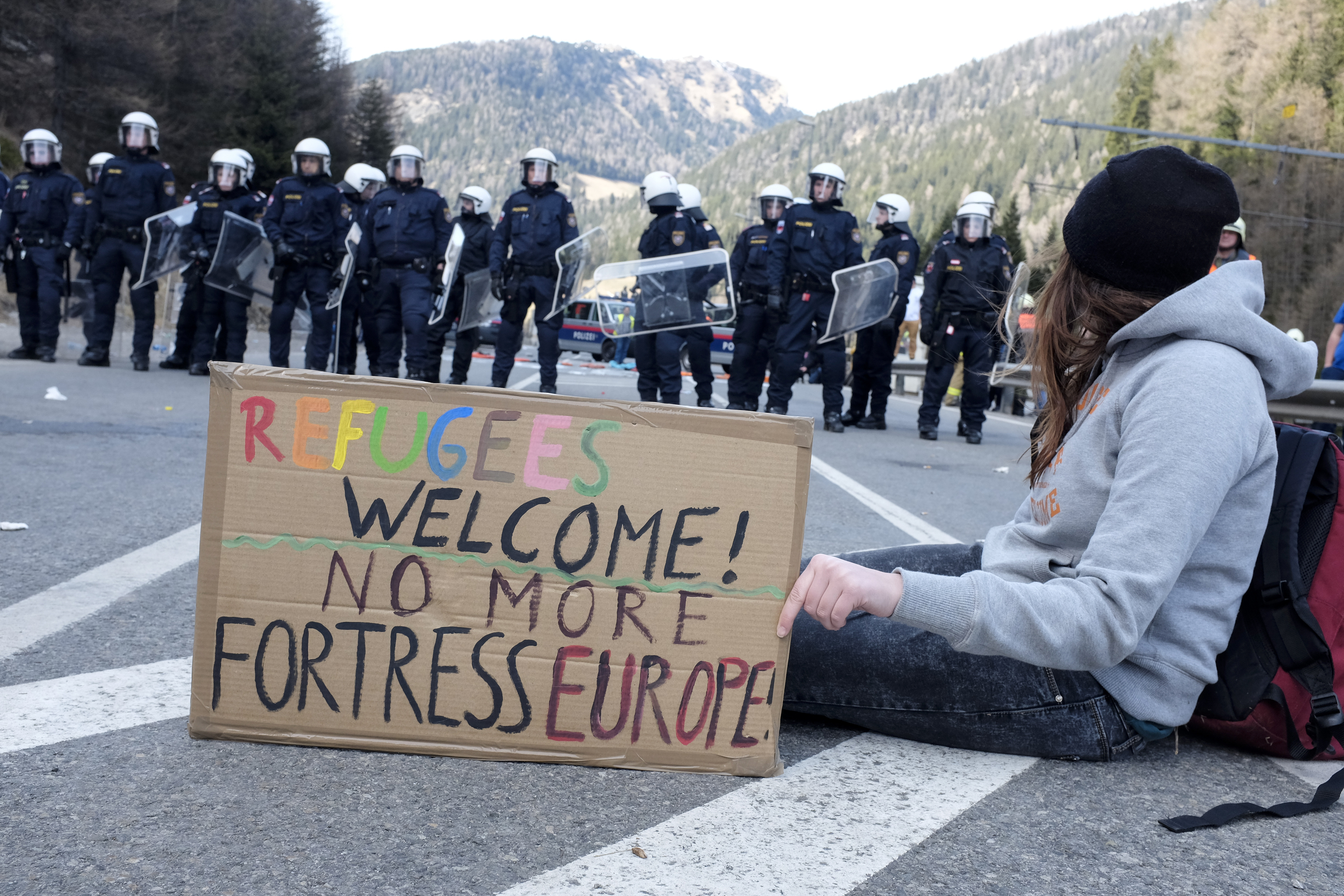 MATREI AM BRENNER, AUSTRIA - 03 APRIL 2016: The Austrian police try to control the protest against the closing of the border between Austria and Italy during the #Noborder rally held near Brennero.