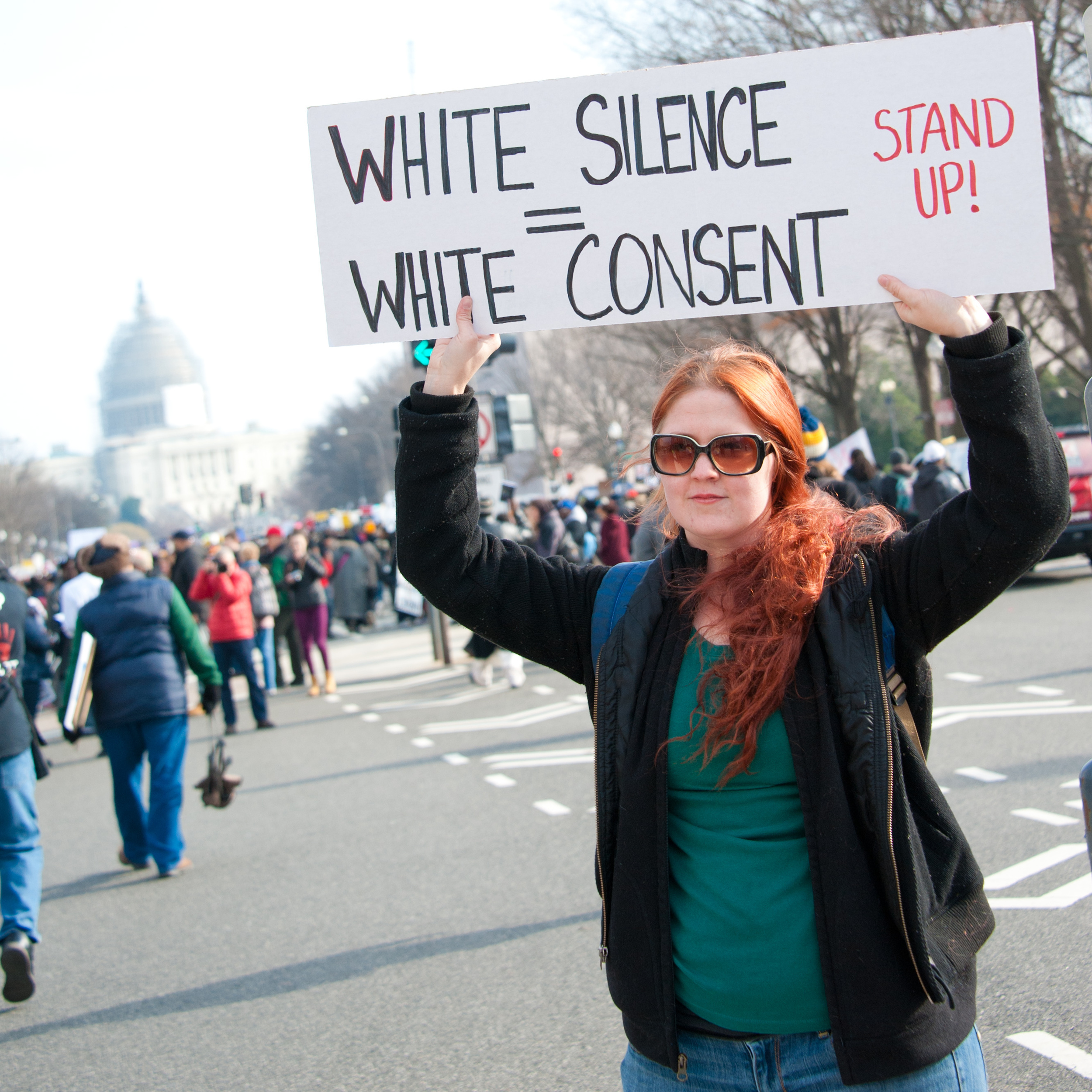 WASHINGTON - DECEMBER 13: A protester holds a sign during a march against police shootings and racism during a rally in Washington, DC on December 13, 2014.