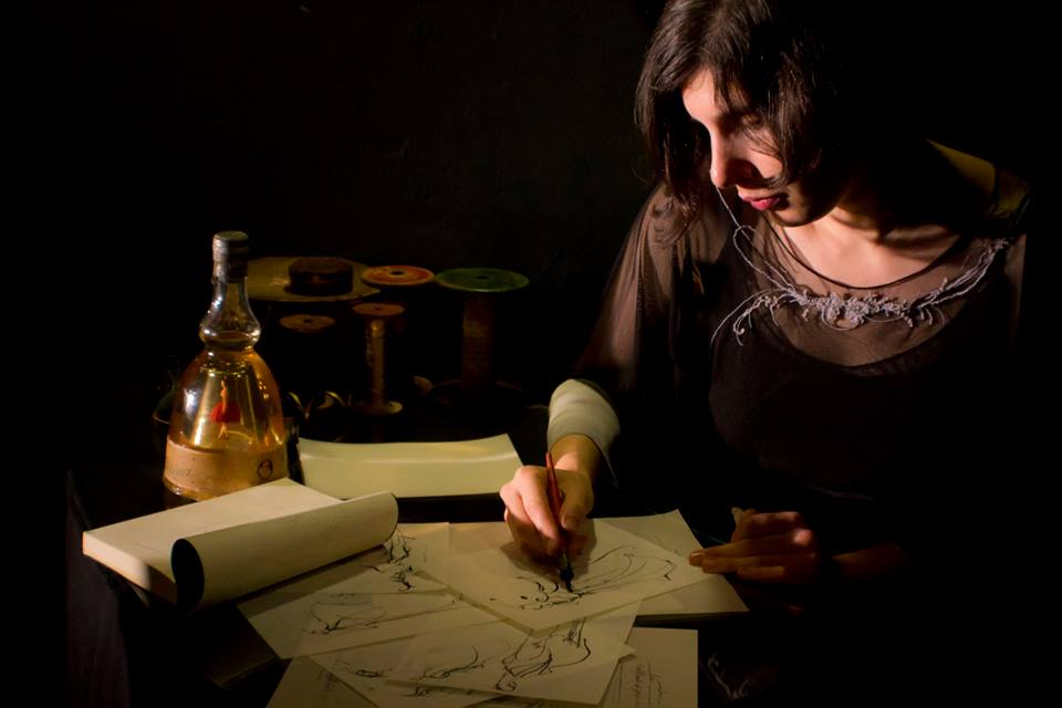 Natalie Capelli making some sketches in the atelier