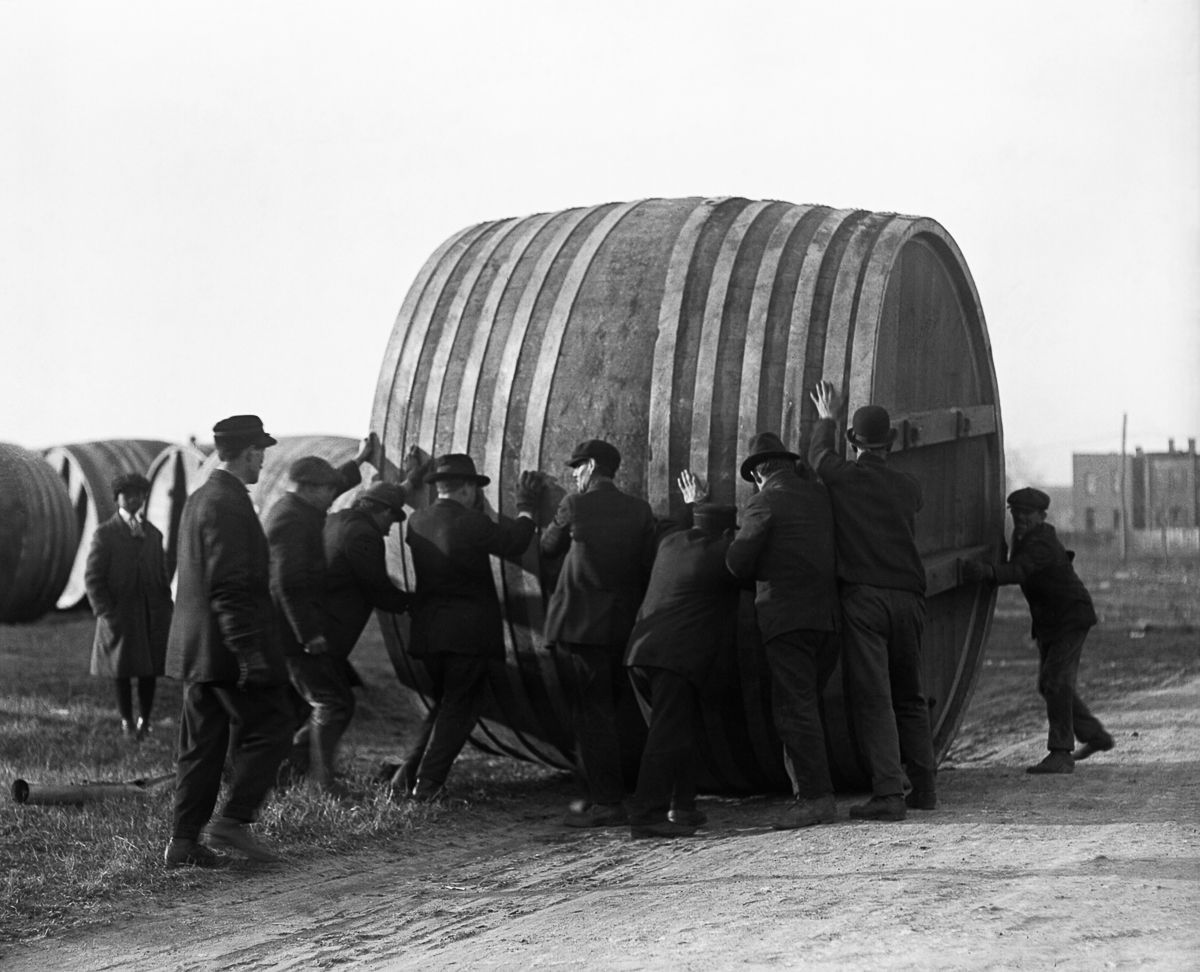 Workers roll away beer vats at a brewery in Washington, D.C. switching from brewing beer to making ice cream. 1920