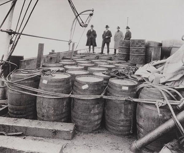 Prohibition agents examine liquor confiscated from a captured rum runner, 1924