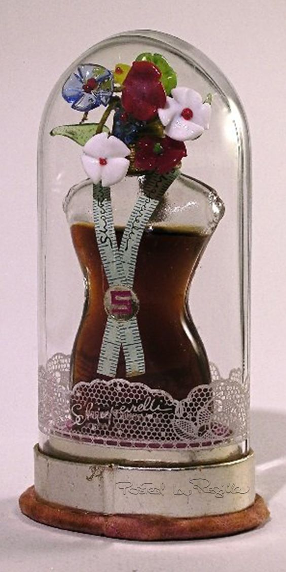 """One of the beautiful bottles of Schiaparelli's perfumes. This is a 1937 bottle of """"Shocking"""" perfume by Elsa Schiaparelli"""