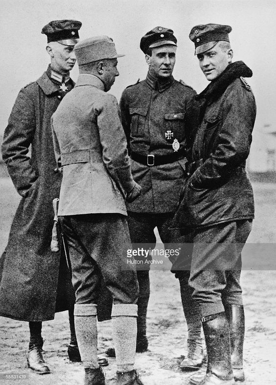 The Red Baron (first on the right) talking to fellow officers.