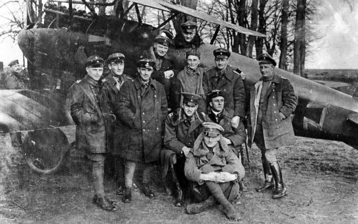 Manfred Von Richthofen and the fliers of his Jasta 11. The Red Baron appears in the cockpit.