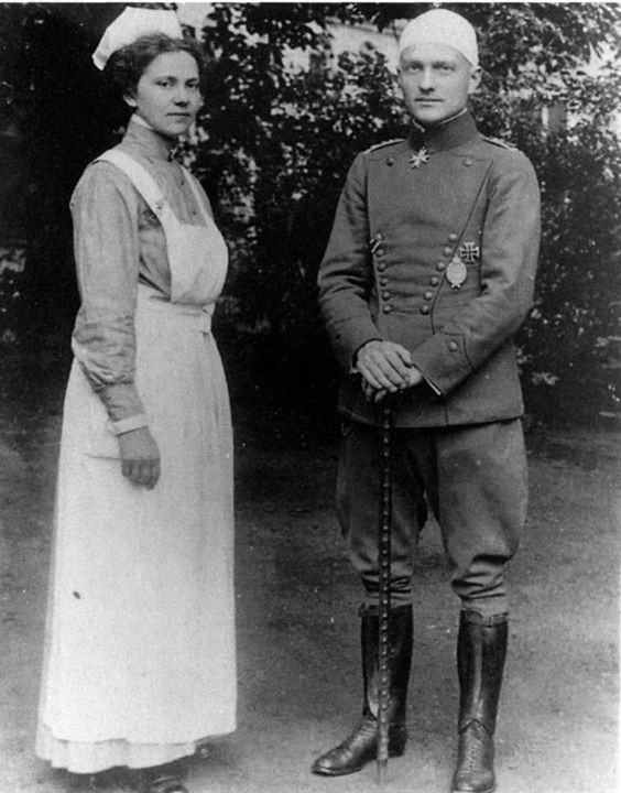 Manfred von Richthofen with nurse Fraulein Kätie Otersdorf. She used to take care of him at the avition facility during his convalescence. Von Richthofen holds the  Geschwader­stock , the walking stick which became his badge of office.