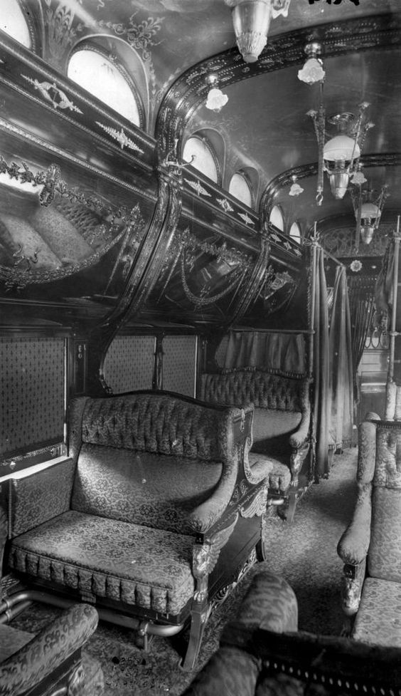 Inside one of the US Pullman Cars, 1900.  They were designed to revolutionize the way people traveled by railroad. These new cars provided comfort to those who rode with a variety of different and fun opportunities. They had everything from Dining cars to sleeping cars.