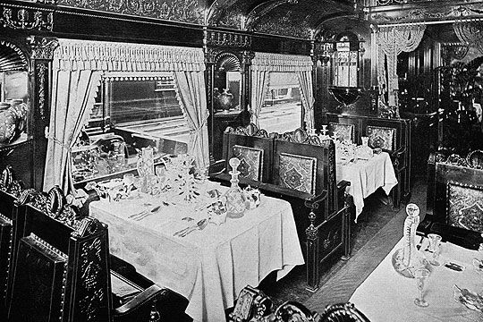 Inside of the restaurant car, 1893.  The fine interiors are so gorgeous and carefully tended.