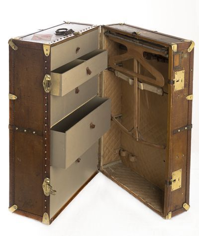 Moynat   wardrobe trunk combined functional with aesthetic., 1920.  Original trunk showed at the exhibit. Moynat was one of the first trunk producer together with LouisVuitton.