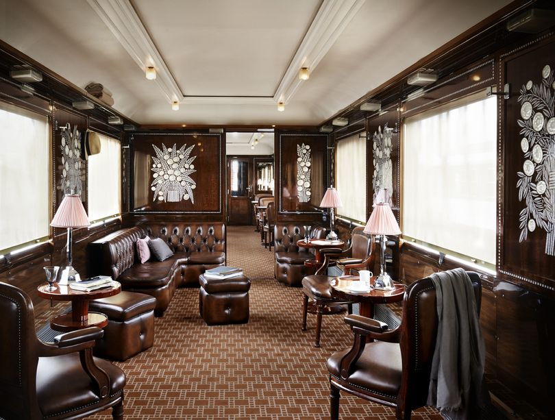 "Inside of the lounge: Cordoba leather sofas, chairs and poufs sorrounded by mahogany wooden panels with Lalique Art Deco bas-reliefs.  ""Once upon a time the Orient Express"", Paris, 2014"