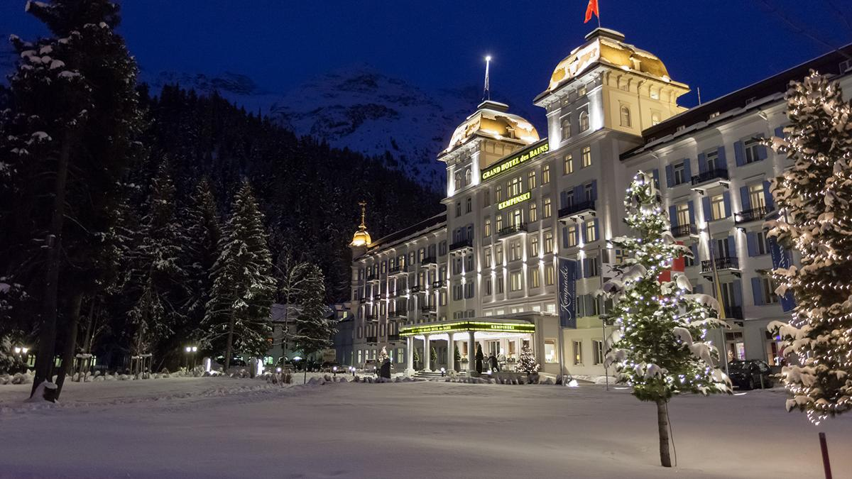 Exterior of the Kempinski Grand Hotel des Bains by night.