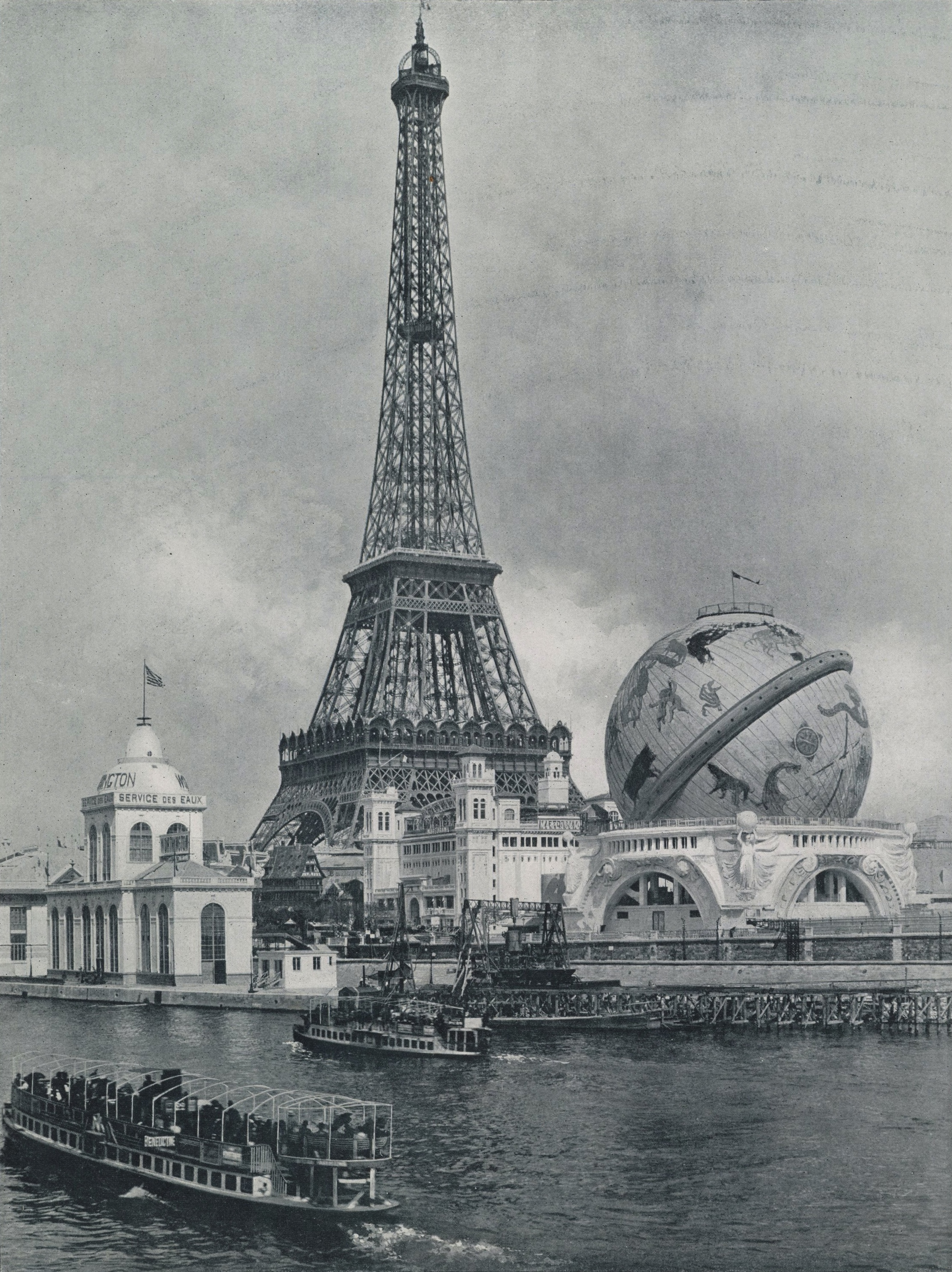"View of the Eiffel Tower and the Celestial Globe, during the  ""Exposition Universelle"" in Paris, 1900 . The globe was decorated with images of constellations, and the pillars on which it stood were decorated with mythological sculptures. 1900"