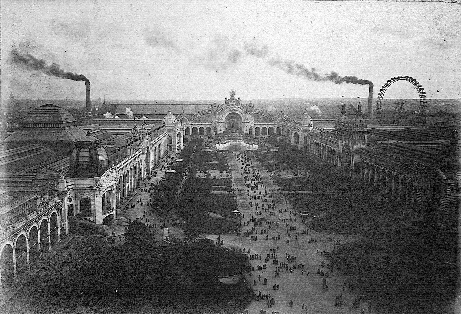 "The ""Champ de Mars"" with the Electricity Building in the background. Picture taken from the Tour Eiffel, 1900"