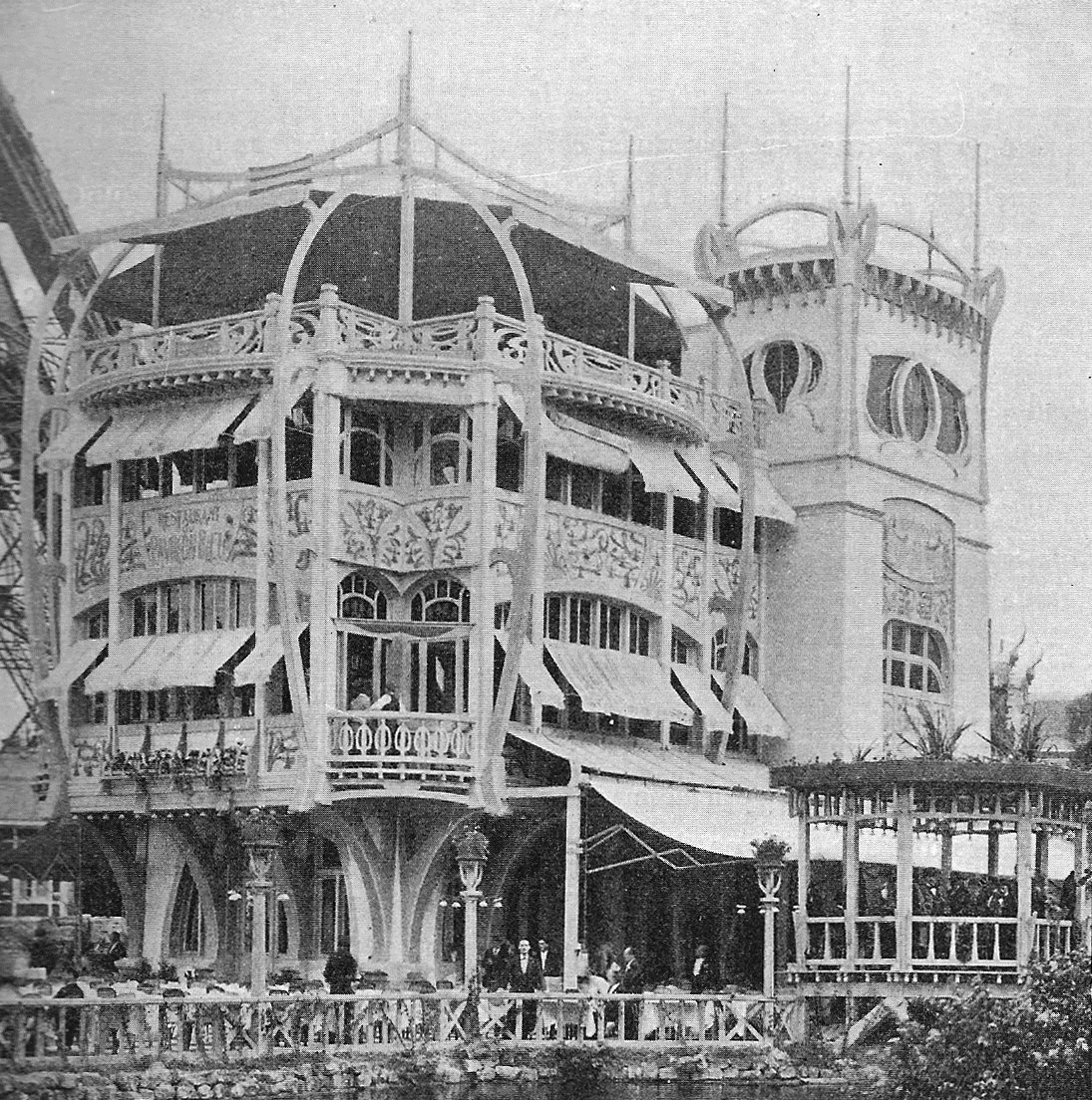 The  Pavillon Bleu  was a  luxury restaurant built for the Universal Exposition of 1900,  ideally located under the Eiffel Tower to attract customers, it differs from dominant eclecticism to adopt an attractive and daring Art Nouveau style, whose originality comes from a blue and yellow bichromy applied to a singularly highlighted wooden structure.
