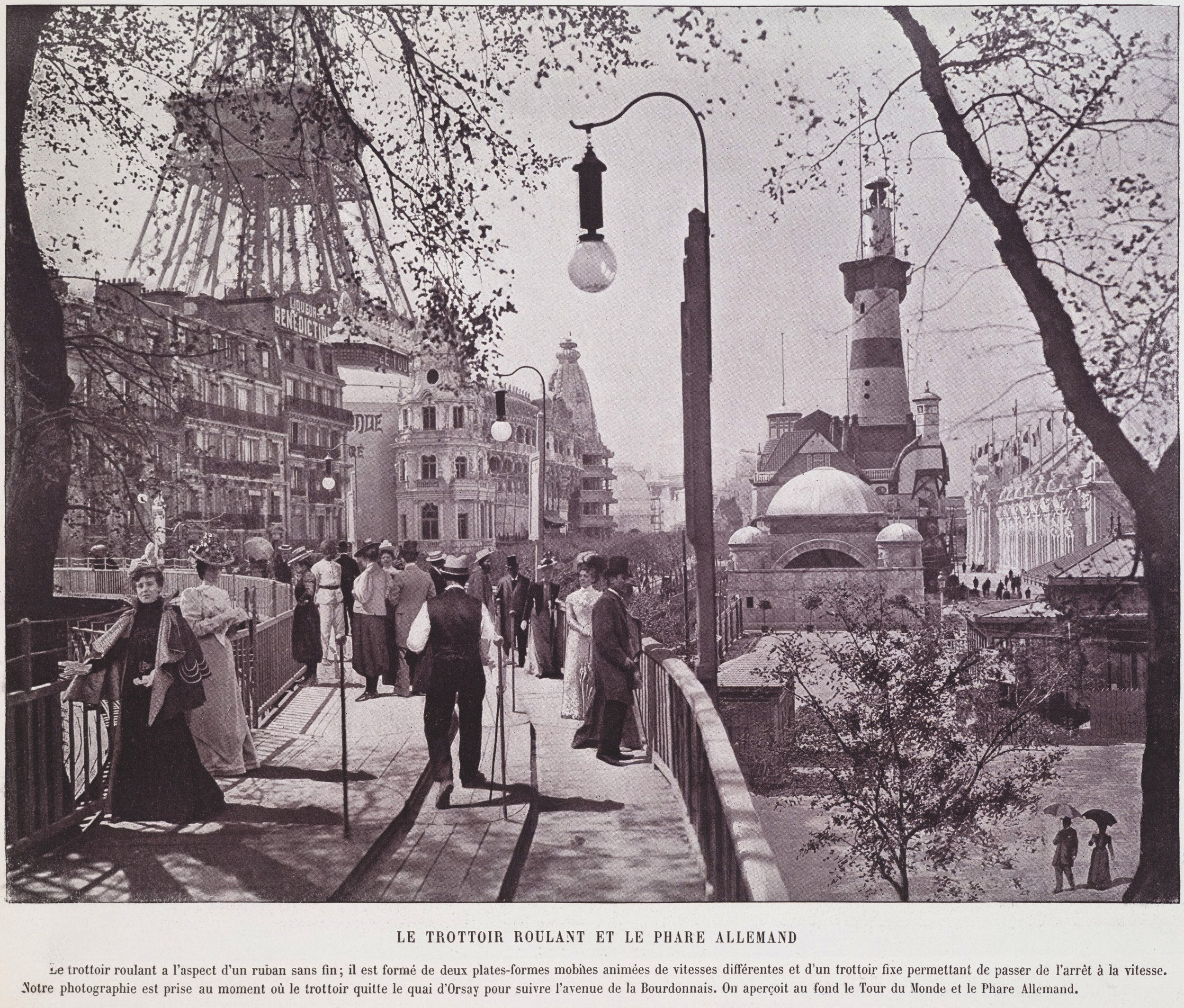 "Another image of the moving walkway at the 1900 Paris world fair. The right platform would have been immobile, while the two left platforms were moving at different speeds. In the background of the image, one can see the German Merchant Navy building and the ""Tour du monde"" at the feet of the Eiffel Tower."
