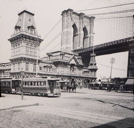 Brooklyn's Fulton Ferry House and Brooklyn Bridge circa 1885.  This view captures the newly built Brooklyn Bridge and Brooklyn's Fulton Ferry House, a beautiful Queen Ann style Victorian building with its ornate mansard roof. This picturesque scene showing street railways, horse carts, telegraph poles and light fixtures are all vestiges of the 19th century that vanished long ago. The photo was taken around 1885 from the corner of Ever