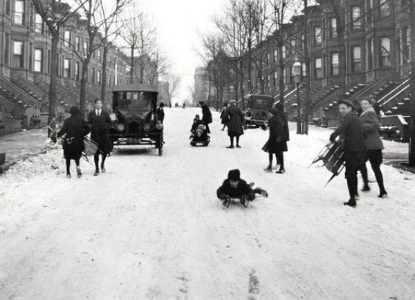 Children sledging on an icy road in Brooklyn, 1924