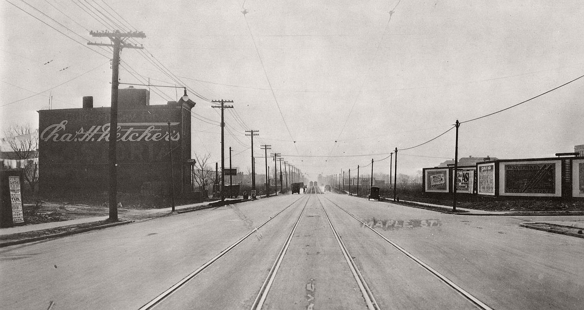 Utica Ave (with virtually nothing built on its sides) looking south to Maple St from East New York Ave. A few 1920s cars zoom along. Brooklyn. 1929
