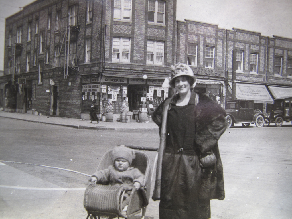 A mother with her baby in the streets of Brooklyn, 1920s