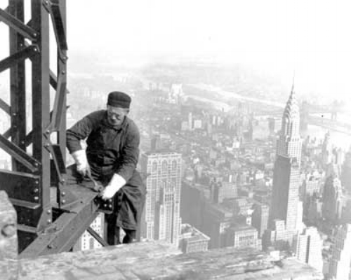 A structural worker on a steel girder during the construction of the Empire State Building, 1930