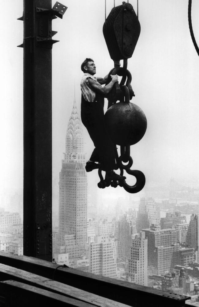 A construction worker hanging from an industrial crane, Empire State Building, 1930