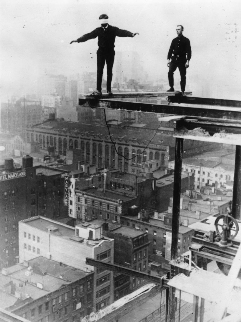 A worker walking blindfolded on a construction girder, New York City, 1925