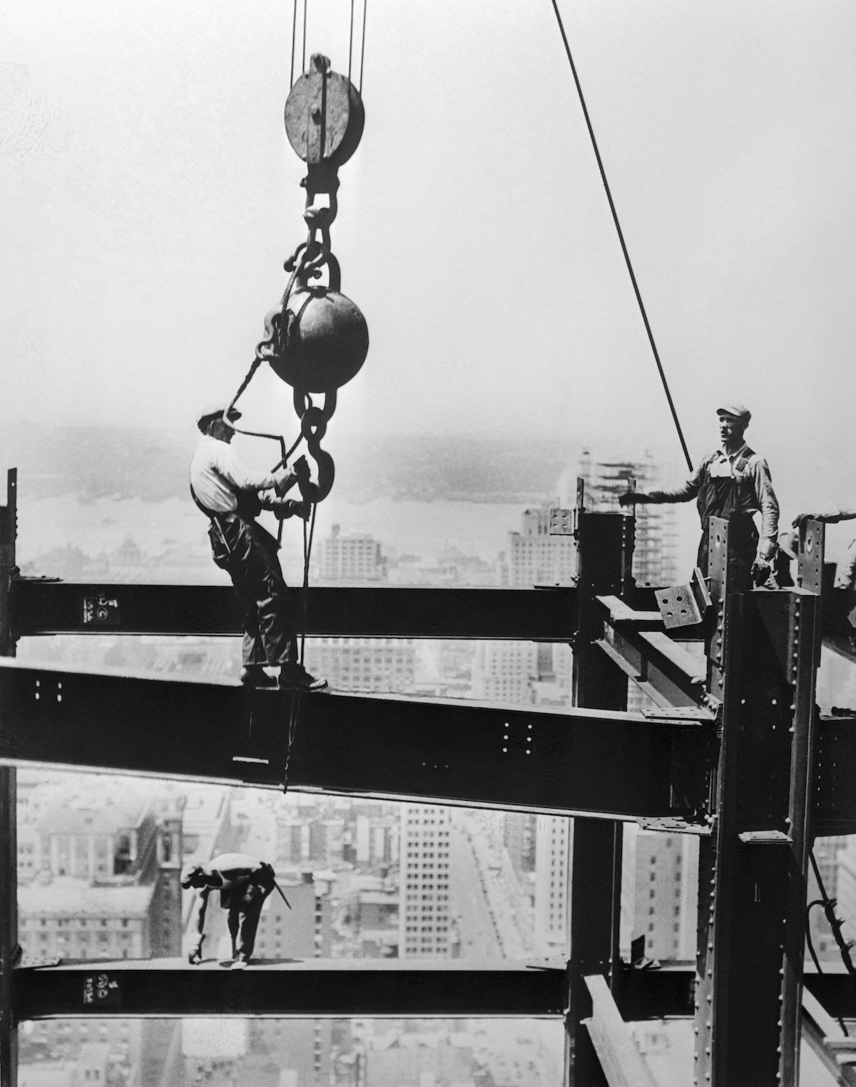 "The ""Cowboys of the Sky"" built those futuristic towers with their bare hands with no kind of protection and very  little guarantee of safety and security.  They did not make use of any harnesses or hard hats. Empire State Building, 1930"