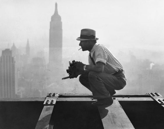 "Charles Clyde Ebbets on the GE building while setting up the iconic "" Lunch atop a Skyscraper"", 1932"