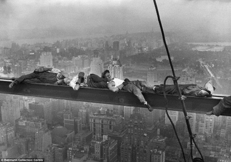 Four construction workers taking a nap on the iron beam. What a safe and relaxing place to have such a break ... Empire State Building, 1932.