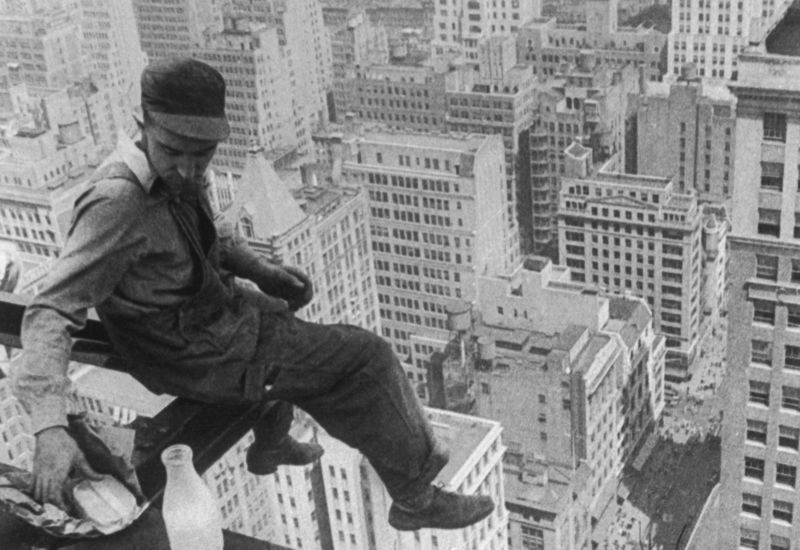 Having lunch at a dizzying height, c. 1930