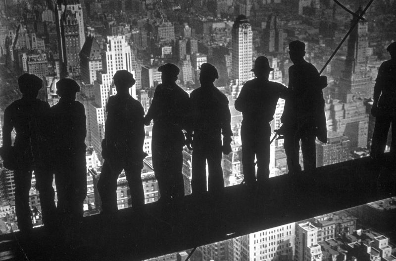A group of steel workers looking New York City from the top of the GE Building (the heart of Rockefeller Center), 1931