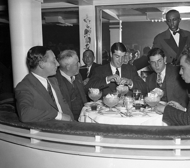 Joe DiMaggio dines at the Cotton Club's new Midtown location after the opening game of the 1937 World Series.