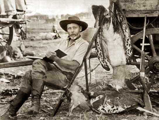 Sir Frederick Selous (1851-1917), British explorer and officer, photographed with his rifle during one of his African safaris, 1890s.