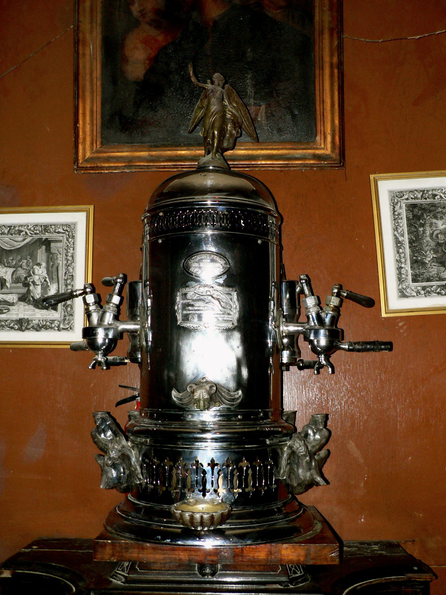 One of the early espresso coffee machine, built in 1900 and first showed to the public at the World Exposition in Turin (Italy) in 1902. This piece of craftmenship from the Belle Epoque period is jealously guarded and cared at the historic Caffé Reggio in New York City.