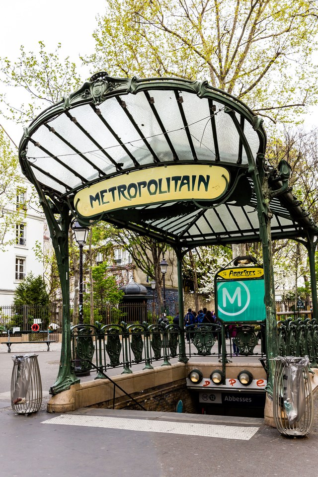 Entrances to the Paris Métro  Follow these signs underground to the vast network that is  Le Métro  in Paris. The system first opened in 1900 with entryways designed by Hector Guimard. Today, Guimard's decorative wrought-iron apertures are emblematic of Art Nouveau Paris.(Courtesy of www.architecturaldigest.com)