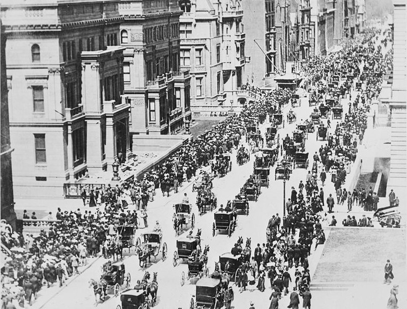 New York City's Fifth Avenue bustling with horse-drawn traffic and two motor cars, 1900