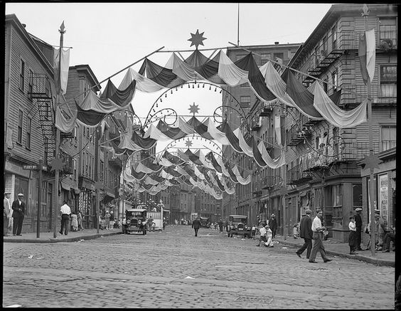 A street in Boston North End decorated for Saints Day. June 23, 1929 (Boston Public Library)
