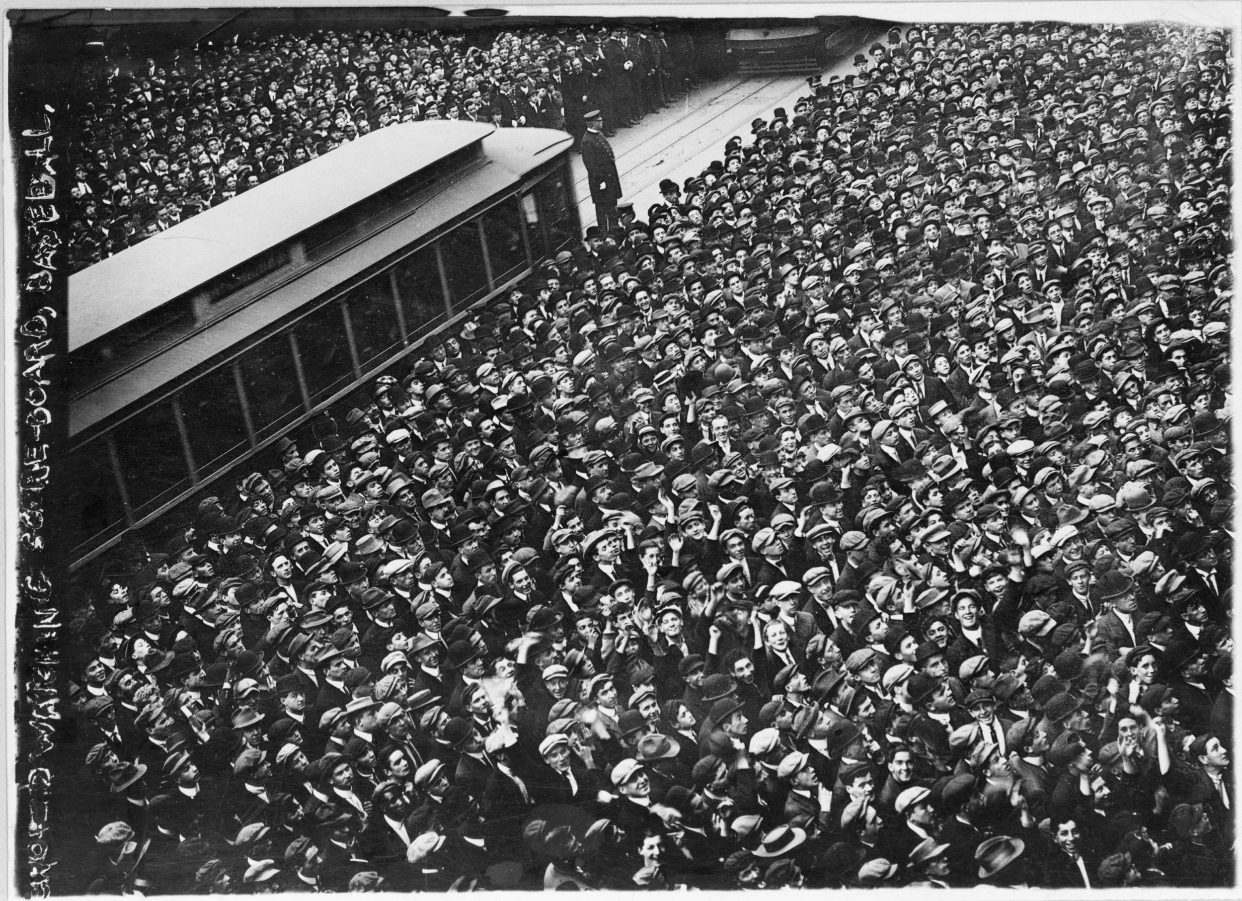 Throngs of baseball fans crowd around a scoreboard in New York to watch for updates on a 1911 World Series game, 1911 (The George Grantham Bain Collection - Library of Congress archive)