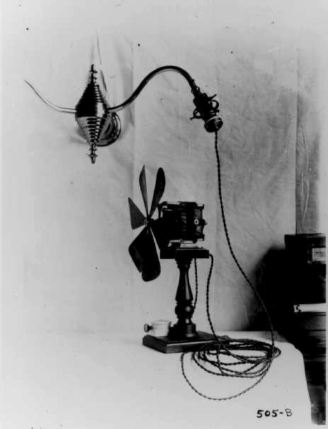 """""""Lighting was often the first use of electricity in homes, and until around 1910 light sockets provided the only access to this power. Thus early appliances like this fan were made with connectors compatible with various manufacturers' light sockets"""" Early fan powered from a light socket, Electricity & Modern Physics Collection, National Museum of American History, Smithsonian Institution, 1910"""