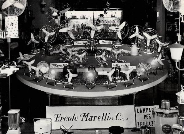 """The shop window of a boutique selling """"Ercole Marelli"""" fans, Milan, 1964"""
