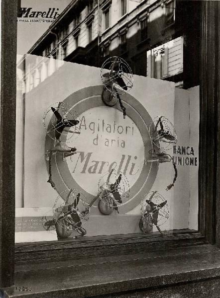 """The shop window of a boutique selling """"Ercole Marelli"""" fans, Milan, 1954"""